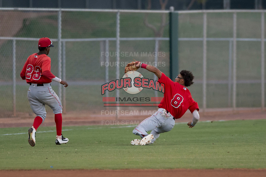 AZL Angels shortstop Jeremiah Jackson (8) makes a sliding catch in front of Daniel Ozoria (23) during an Arizona League game against the AZL Giants Black at the San Francisco Giants Baseball Complex on July 1, 2018 in Scottsdale, Arizona. AZL Giants Black defeated the AZL Angels 4-2. (Zachary Lucy/Four Seam Images)