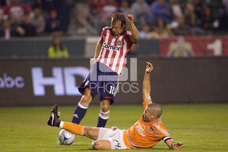 Houston Dynamo defender Wade Barrett slides Chivas USA's Carey Talley. The Houston Dynamo and Chivas USA played to a 1-1 tie at Home Depot Center stadium in Carson, California on Saturday October 25, 2008. Photo by Michael Janosz/isiphotos.com
