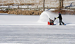 MIDDLEBURY, CT-122717JS01----Matthew Cosmos of MIddlebury spent Wednesday afternoon clearing snow off Fenn Pond in Middlebury so locals can play hockey now that the ice is thick enough. Cosmos, who grew up playing on the pond, is a graduate of Pomperaug High School and played hockey at UMASS-Boston as well as professional hockey for a number of teams including the New Mexico Scorpions, the Twin City Cyclones and the Danbury Mad Hatters. Cosmos continues to play on the pond and wants other young kids to have the same opportunity.  Jim Shannon Republican-American