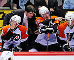 7 December 2009: Philadephia Flyers' newly appointed Head Coach Peter Laviolette listens to comments from Jeff Carter (17) on the bench during a game against the Montreal Canadiens at the Bell Centre in Montreal, Quebec, Canada. The Canadiens defeated the Flyers 3-1. Mandatory Credit: Ed Wolfstein Photo