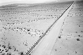 Calexico, California<br /> USA<br /> August 21, 2007<br /> <br /> In 2007 the National Guard has placed miles of vehicles barriers along a stretch of open desert west of Calexico. It marks the border between the US and Mexico. The barrier now blocks what was once an open road for drug smugglers who simply drove vehicles loaded with drugs into the US.