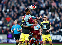 29th February 2020; London Stadium, London, England; English Premier League Football, West Ham United versus Southampton; Sebastien Haller of West Ham United heads the ball towards Goalkeeper Alex McCarthy of Southampton under pressure from Ryan Bertrand of Southampton