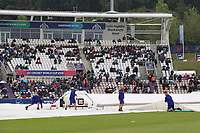 The ground staff get the covers in place as play is halted through rain  during South Africa vs West Indies, ICC World Cup Cricket at the Hampshire Bowl on 10th June 2019