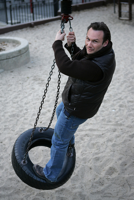 CHRISTIAN SLATER on a tire swing in Central Park.  He was a late addition to the cast of THE GLASS MENAGERIE.  Newsday/ARI MINTZ  3/17/2005.