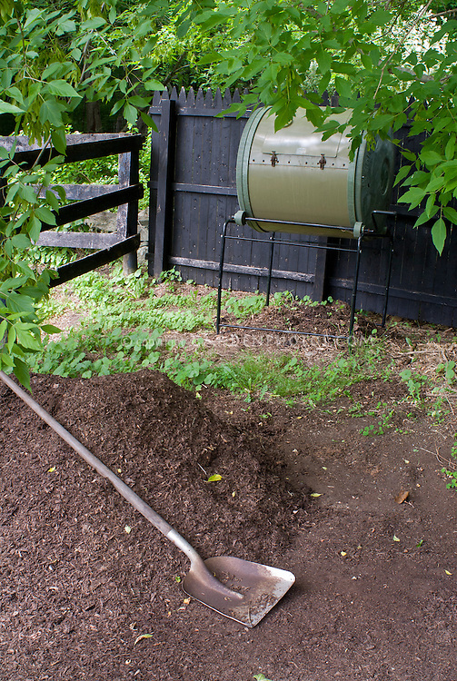 Compost bin rolling type, soil, shovel, digging, finished compost for organic gardening soil amendments