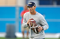 30 March 2012:  FIU Assistant Coach Jeff Popovich puts players through drills prior to the FIU Football Spring Game at University Park Stadium in Miami, Florida.