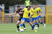 Danny Newton of Stevenage and Scott Shulton of St Albans battle for the ball during St Albans City vs Stevenage, Friendly Match Football at Clarence Park on 13th July 2019