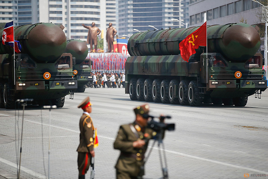 Missiles are driven past the stand with North Korean leader Kim Jong Un and other high ranking officials during a military parade marking the 105th birth anniversary of country's founding father, Kim Il Sung in Pyongyang, April 15, 2017.    REUTERS/Damir Sagolj