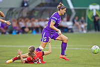 Portland, Oregon - Sunday April 17, 2016: Orlando Pride defender Laura Alleway (5) and Portland Thorns FC midfielder Tobin Heath (17). The Portland Thorns play the Orlando Pride during a regular season NWSL match at Providence Park.