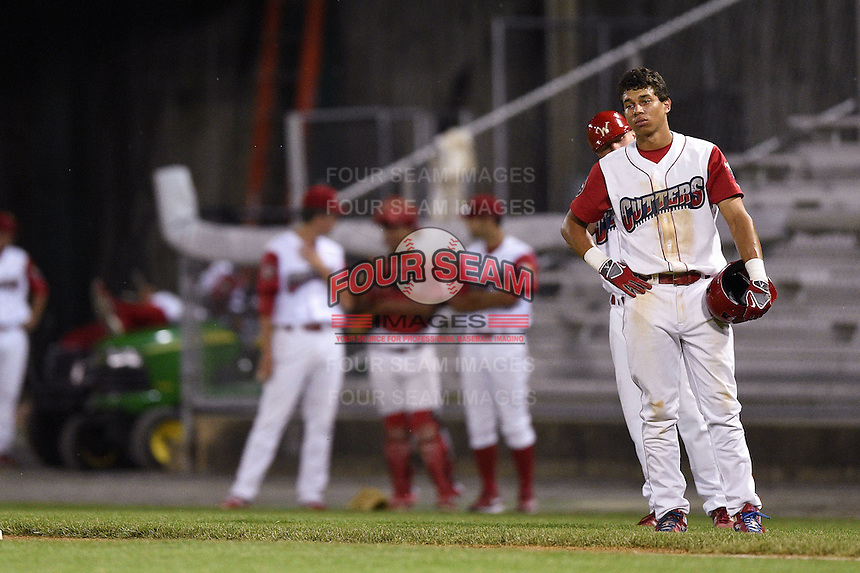 Williamsport Crosscutters third baseman Jan Hernandez (11) looks on after his broken bat hit pitcher Ivan Hernandez (not shown) in the head during a game against the Aberdeen IronBirds on August 4, 2014 at Bowman Field in Williamsport, Pennsylvania.  Aberdeen defeated Williamsport 6-3.  (Mike Janes/Four Seam Images)