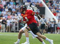 Baltimore, MD - April 28, 2018: Maryland Terrapins Colin Giblin (4) holds off a Johns Hopkins Blue Jays defender during game between John Hopkins and Maryland at  Homewood Field in Baltimore, MD.  (Photo by Elliott Brown/Media Images International)