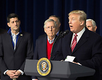 United States President Donald J. Trump makes remarks to the media at Camp David, the presidential retreat near Thurmont, Maryland after holding meetings with staff, members of his Cabinet and Republican members of Congress to discuss the Republican legislative agenda for 2018 on January 6, 2018.   Looking on is Speaker of the US House Paul Ryan (Republican of Wisconsin) and US Senate Majority Leader Mitch McConnell (Republican of Kentucky).<br /> CAP/MPI/RS<br /> &copy;RS/MPI/Capital Pictures
