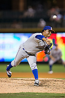 Durham Bulls relief pitcher Jose Dominguez (36) delivers a pitch to the plate against the Charlotte Knights at BB&T BallPark on July 22, 2015 in Charlotte, North Carolina.  The Knights defeated the Bulls 6-4.  (Brian Westerholt/Four Seam Images)