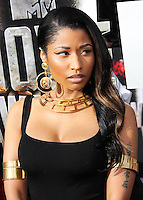 LOS ANGELES, CA, USA - APRIL 13: Singer Nicki Minaj wearing a floor-length, black gown by Alexander McQueen, with gold cuffs, a large gold necklace and a gorgeous ring by John Hardy arrives at the 2014 MTV Movie Awards held at Nokia Theatre L.A. Live on April 13, 2014 in Los Angeles, California, United States. (Photo by Xavier Collin/Celebrity Monitor)
