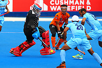 Ramandeep Singh of India beats the Malaysian goalkeeper Kumar Subramiam to score his second goal of the match during the Hockey World League Quarter-Final match between India and Malaysia at the Olympic Park, London, England on 22 June 2017. Photo by Steve McCarthy.