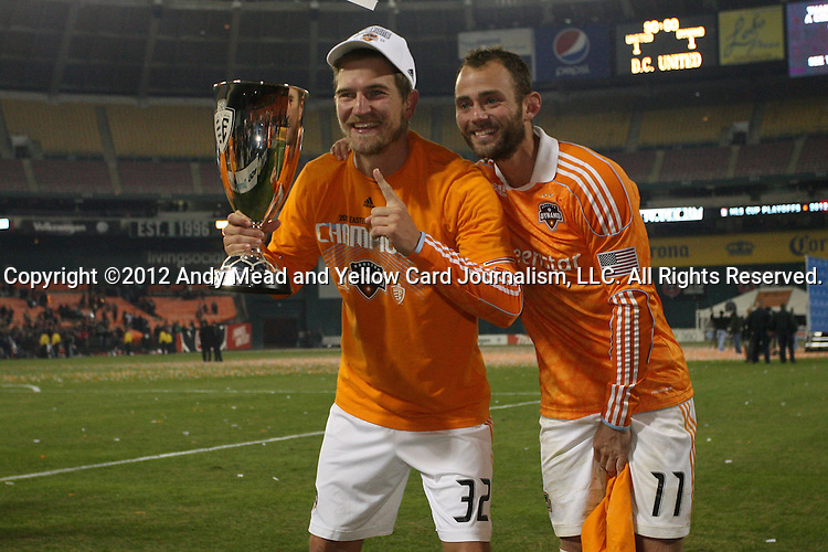 18 November 2012: Houston's Bobby Boswell (32) and Brad Davis (11) pose with the Eastern Conference Trophy. DC United played the Houston Dynamo at RFK Stadium in Washington, DC in the second leg of their 2012 MLS Cup Playoffs Eastern Conference Final series. The game ended in a 1-1 tie, Houston won the series 4-2 on aggregate goals.