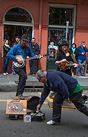 """French Quarter, New Orleans, Louisiana.  Making a Donation to Street Performers, Royal Street.  Tap Dancer and Banjo Player.  """"13 Strings and a Two Dollar Bill."""""""