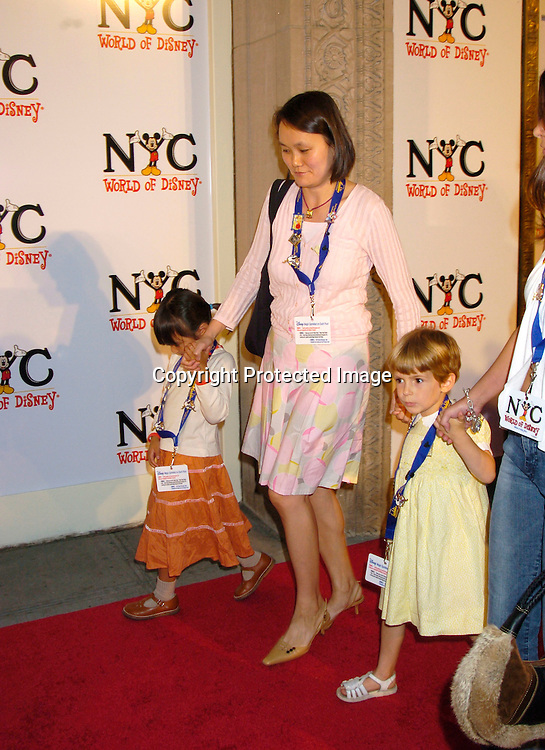Soon-Yi Previn and her children Bechet and Manzie ..at the World of Disney Store opening on October 4, 2004 ..on Fifth Avenue in New York City. Photo by Robin Platzer, Twin Images