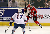 February 22nd 2008:  Matt Kinch (2) of the Binghamton Senators controls the puck during a game as Dan Collins (17) defends vs. the Rochester Amerks at Blue Cross Arena at the War Memorial in Rochester, NY.  The Senators defeated the Amerks 4-0.   Photo copyright Mike Janes Photography