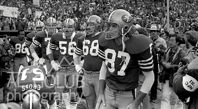 San Francisco 49ers vs.Dallas Cowboys at Candlestick Park Sunday, January 10. 1982..49ers beat Cowboys 28-27 for Conference Championship..List of Payers:  (87) Dwight Clark, (68) John Ayers, (56) Fred Quillan, ..Photo By Al Golub/Golub Photography.
