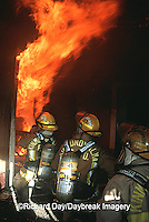 63818-01511 Firefighters fighting fire inside burning house  Kinmundy-Alma Fire District,  Kinmundy IL