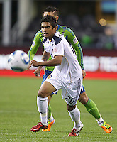 L.A. Galaxy defender A.J. DeLaGarza chases down the ball during play against the Seattle Sounders FC at Qwest Field in Seattle Tuesday March 15, 2011. The Galaxy won the game 1-0.