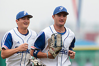 27 july 2010: Joris Bert of France runs back to the dugout next to Kenji Hagiwara during France 8-2 victory over Belgium, in day 5 of the 2010 European Championship Seniors, in Stuttgart, Germany.
