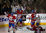 3 February 2007: Montreal Canadiens defenseman Mark Streit of Switzerland (center) celebrates the Canadiens' second goal with teammates Francis Bouillon (51) and Alexander Perezhogin (42) of Kazakhstan in the second period against the New York Islanders at the Bell Centre in Montreal, Canada. The Islanders defeated the Canadiens 4-2.