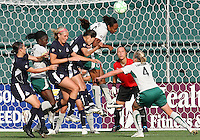 Homare Sawa #10 of the Washington Freedom loses an aerial battles with Kia McNeill #6  of St. Louis Athletica during a WPS match at RFK Stadium on July 18 2009, in Washington D.C. Freedom won the match 1-0.