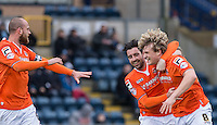 Cameron McGeehan of Luton Town celebrates his winning goal with teammates during the Sky Bet League 2 match between Wycombe Wanderers and Luton Town at Adams Park, High Wycombe, England on 6 February 2016. Photo by Andy Rowland.
