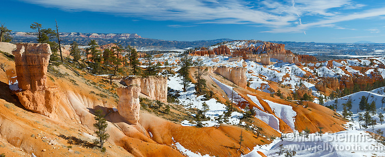 Panorama of the rock formations in the lower elevations of Bryce Amphitheater, Bryce Canyon National Park, Utah. Technically not a canyon, most of the erosion at Bryce comes from the freezing and thawing of water, a prevalent occurence due to its high elevation of approximately 7,000 to 9,000 feet (2,133 - 2,743 m). In addition to ice, wind and water erosion also play a role.