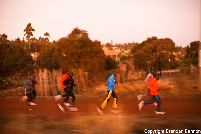 Kenyan track star Moses Masai, front in red, trains with a group of runners in Iten, Kenya.