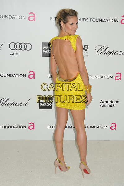 Heidi Klum.20th Annual Elton John Academy Awards Viewing Party held at West Hollywood Park, West Hollywood, California, USA..February 26th, 2012.full length yellow gold embroidered sleeveless dress backless looking over shoulder shoes .CAP/ADM/BP.©Byron Purvis/AdMedia/Capital Pictures.