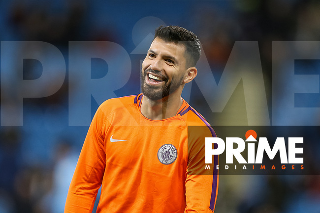 Smiles from Sergio AGUERO of Manchester City as he warms up ahead of the UEFA Champions League match between Manchester City and Olympique Lyonnais at the Etihad Stadium, Manchester, England on 19 September 2018. Photo by David Horn / PRiME Media Images.