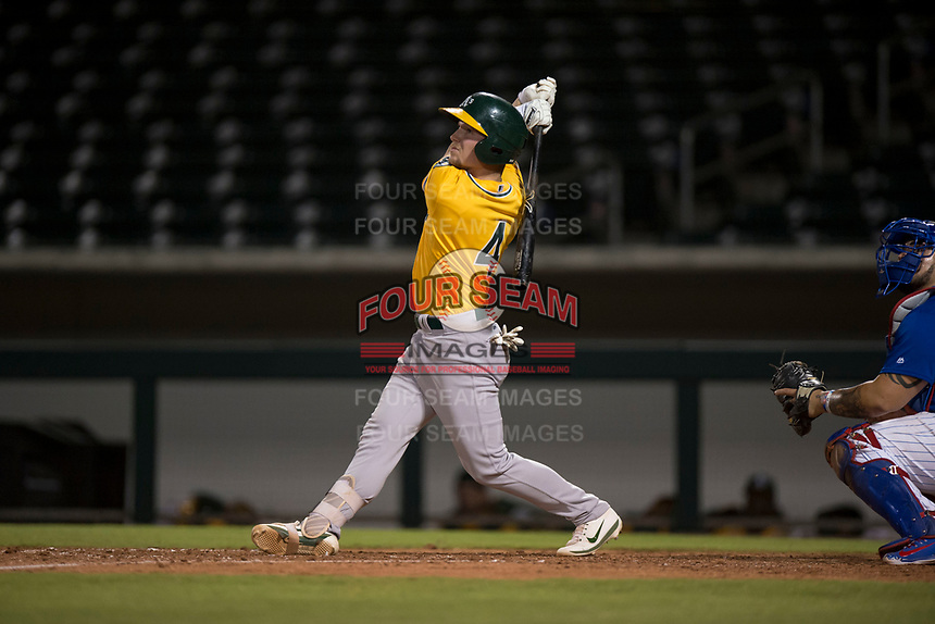 AZL Athletics designated hitter Nick Ward (4) follows through on his swing during an Arizona League game against the AZL Cubs 1 at Sloan Park on June 28, 2018 in Mesa, Arizona. The AZL Athletics defeated the AZL Cubs 1 5-4. (Zachary Lucy/Four Seam Images)