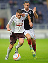 Hearts' Jamie Walker gets away from Falkirk's Andy Haworth.