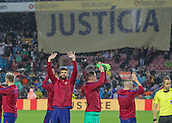 4th November 2017, Camp Nou, Barcelona, Spain; La Liga football, Barcelona versus Sevilla; FC Barcelona players salute the crowd with a 'Justicia' flag behind them