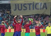 4th November 2017, Camp Nou, Barcelona, Spain; La Liga football, Barcelona versus Sevilla; FC Barcelona players salute the crowd with a 'Justicia' flag behind them