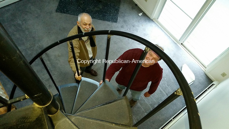 SOUTHBURY, CT: 23 Nov. 2015:112315BB02: SOUTHBURY ---- Joe Battaglia of Southbury, left, and Lou Valenti, operations director for HomeFront, check out a spiral staircase in a house on River Trail to determine if it can be used in a project for a low income homeowner. Bill Bittar Republican-American