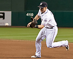 Reno Aces first baseman Mike Jacobs make the play on a gronder agianst the Sacramento River Cats during their play off game on Saturday night September 8, 2012 at Aces Ballpark in Reno NV.