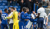 Ngolo Kante of Chelsea swops shirts with Moussa Sissoko of Spurs at full time during the Premier League match between Chelsea and Tottenham Hotspur at Stamford Bridge, London, England on 1 April 2018. Photo by Andy Rowland.