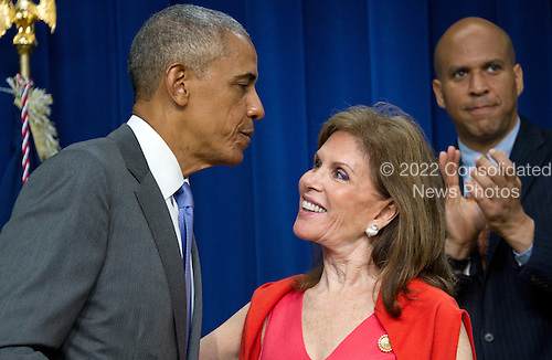 United States President Barack Obama and Bonnie Lautenberg, widow of US Senator Frank Lautenberg (Democrat of New Jersey) prior to his signing H.R. 2576, the Frank R. Lautenberg Chemical Safety for the 21st Century Act in the South Court Auditorium of the White House in Washington, DC on Wednesday, June 22, 2016. The bill will establish standards for the use of certain toxic chemicals used regularly.  US Senator Cory Booker (Democrat of New Jersey) looks on from right.<br /> Credit: Ron Sachs / CNP