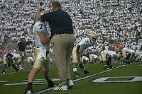 08 September 2007:  Notre Dame coach Charlie Weis pats QB  Jimmy Clausen on the head during warm ups..The Penn State Nittany Lions defeated the Notre Dame Fighting Irish 31-10 September 8, 2007 at Beaver Stadium in State College, PA..