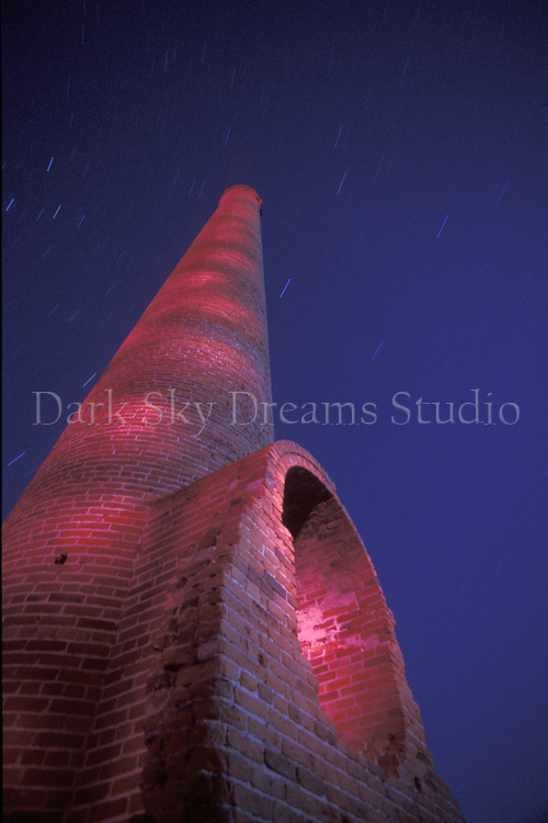 The brick smokestack towers over the ruins of the Combination Mill in the ghost town of east Belmont, Nevada