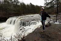 NWA Democrat-Gazette/FLIP PUTTHOFF<br />Thao Nguyen of Fayetteville       Feb. 23 2018        admires Falling Water Falls, along Falling Water Creek in the Ozark National Forest. The waterfall and others are easily reached by car along Forest Road 1205 near the Ben Hur community.
