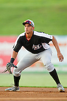 Hickory Crawdads first baseman Ronald Guzman (22) on defense against the Kannapolis Intimidators at CMC-Northeast Stadium on July 26, 2013 in Kannapolis, North Carolina.  The Intimidators defeated the Crawdads 2-1.  (Brian Westerholt/Four Seam Images)