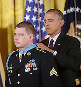 United States President Barack Obama awards Kyle J. White, a former active duty U.S. Army Sergeant, the Medal of Honor for conspicuous gallantry in the East Room of the White House, May 13, 2014 in Washington, DC. <br /> Credit: Olivier Douliery / Pool via CNP