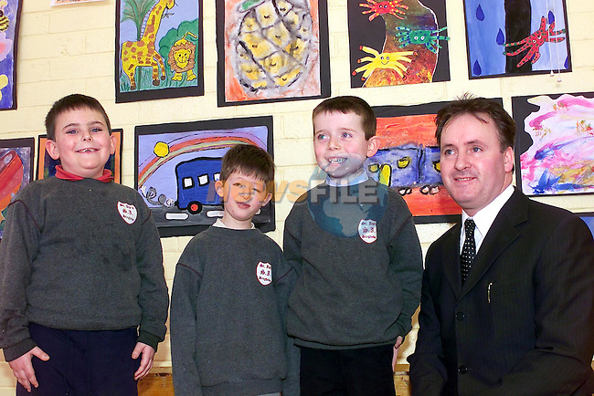 Andrew Kavanagh, Ciaran Coyle and ian McNamee with ken Healy of Apline Furniture sponsors of the art competition..Picture Fran Caffrey Newsfile.