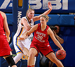 BROOKINGS, SD - JANUARY 17:  Clarissa Ober #21 from South Dakota State holds her position as Margaret McCloud #30 from the University of South Dakota back her down in the first half of their game Sunday afternoon at Frost Arena in Brookings, S.D. (Photo by Dave Eggen/Inertia)