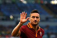 Calcio, Serie A: Roma-Genoa. Roma, stadio Olimpico, 12 gennaio 2014.<br /> AS Roma forward Francesco Totti waves to fans during the Italian Serie A football match between AS Roma and Genoa, at Rome's Olympic stadium, 12 January 2014. <br /> UPDATE IMAGES PRESS/Riccardo De Luca